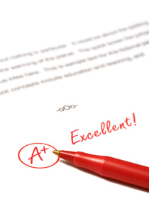 "A scientific paper is sitting on a white background. The paper has ""A+, Excellent!"" written on it in red pen."