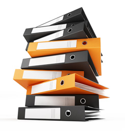 A stack of black and orange binders filled with technical writing on a white background.