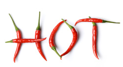 "The word ""hot"" is spelled out on a white background using skinny red peppers; ""hot"" is an example of an adjective."