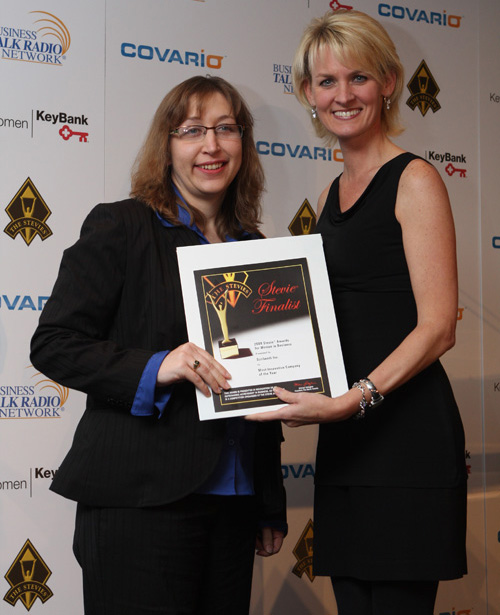 Scribendi.com President, Chandra Clarke, receives her finalist award from Carolyn Kepcher, former Executive Vice President of The Trump Organization