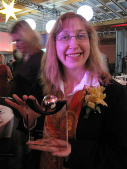 Scribendi.com President, Chandra Clarke, is holding the Ontario Business Achievement Award.