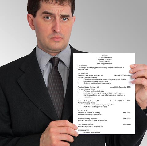 Man with a confused look on his face holding a resume.