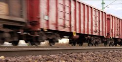 Three freight train cars connected together on a railroad track parallel how conjunctions work in a sentence.