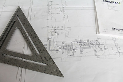 Construction blueprints on a table.