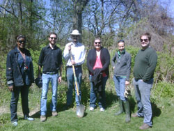 Scribendi.com staff stand with shovels outside of Paxton's Bush in Chatham after planting 150 trees.