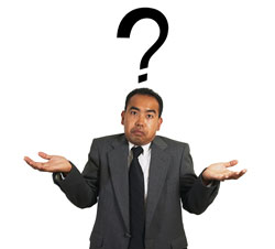 A man in a business suit is shrugging his shoulders with a question mark above his head.