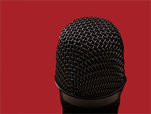 A microphone represents the stand-up comedian.