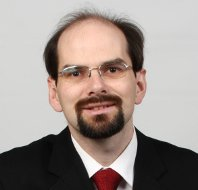 A headshot of Scribendi.com vice-president Terence Johnson. He is wearing a suit and glasses.