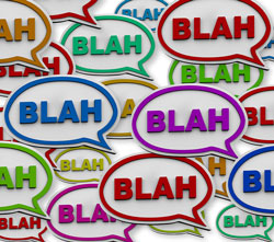 "There are colourful text balloons that read ""blah, blah, blah"" and are meant to depict wordiness in writing."