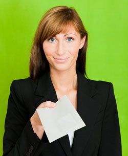 A business woman is facing the camera with her arm extended. She is handing someone an employee recommendation letter sample for their reference.