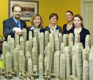 Five members of the Scribendi.com office staff stand with 10,000 peat pots that were donated to the Municipality of Chatham-Kent.